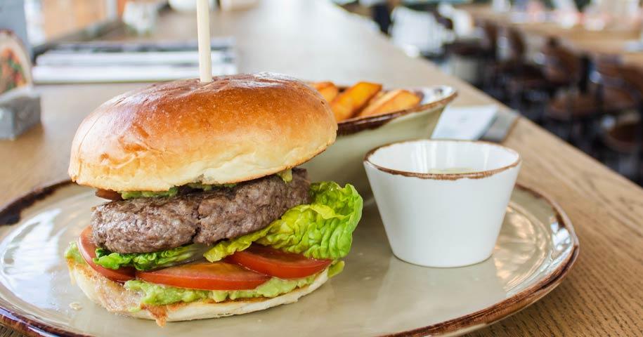 Homemade beef burger on brioche bun
