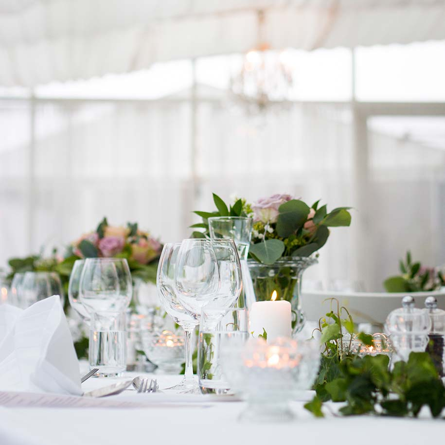 Table with candles in white marquee