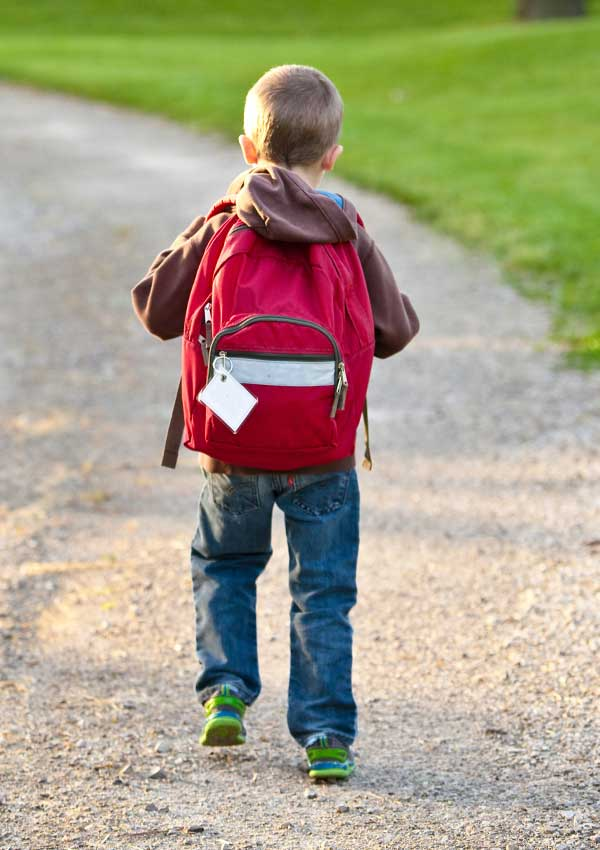 Child with backpack walking
